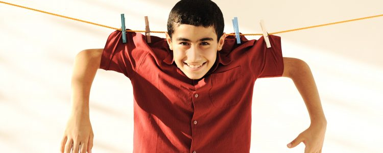 Young kid hanging on a clothesline