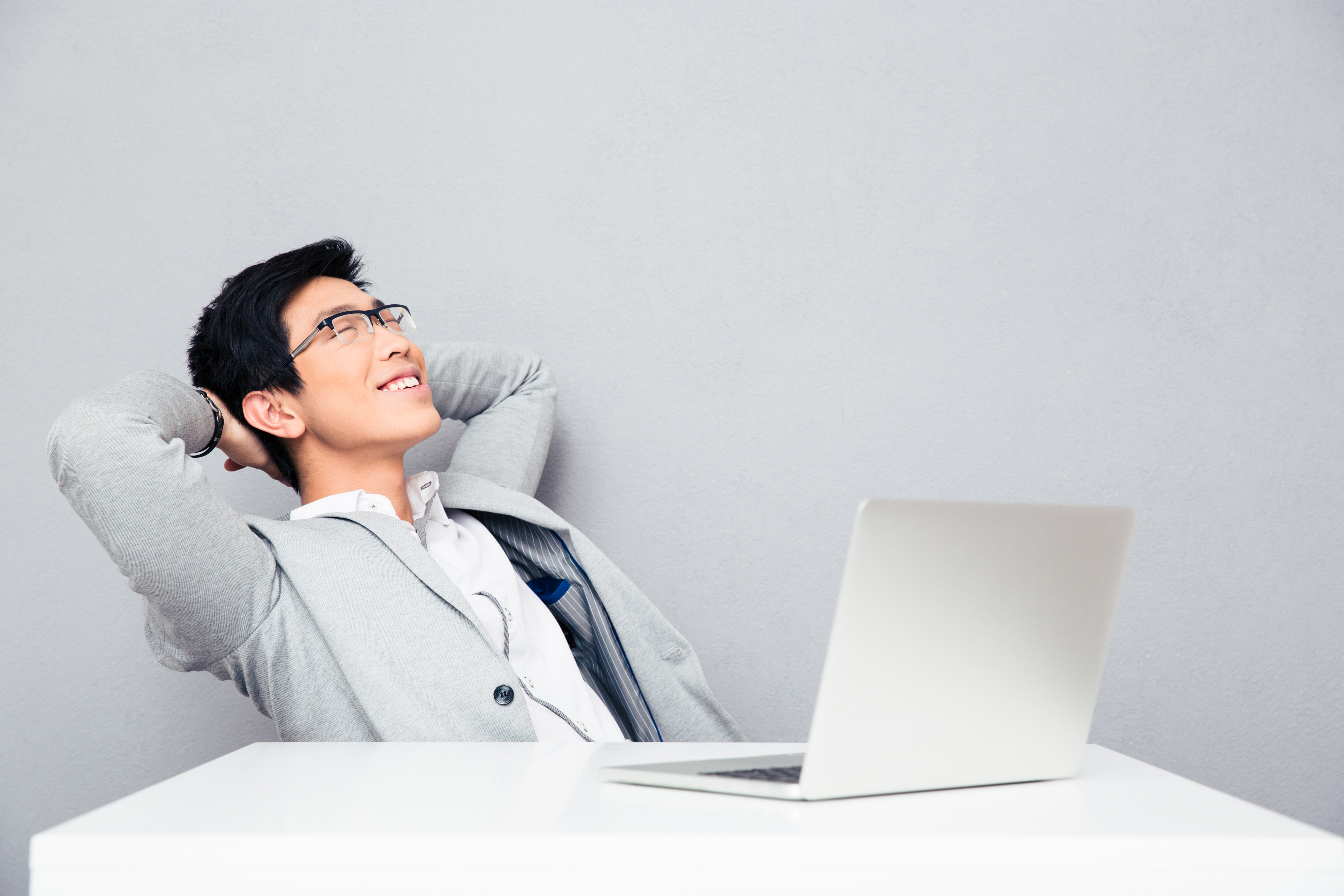 Businessman resting at the table with laptop