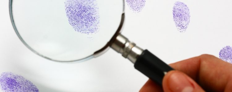 Police Examine A Fingerprint Left By A Suspect